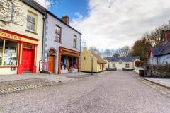 Bunratty Folk Park. BUNRATTY, IRELAND - FEB 19: 19th century village street of Bunratty Folk Park, traditional Irish tourist attraction of Co. Clare Royalty Free Stock Photo