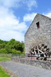 Bunratty Folk Park house with water wheel Stock Images