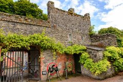 Bunratty , an authentic small village in County Clare, Ireland. BUNRATTY, IRELAND - JULY 13, 2016: House in Bunratty  (End of the Raite river) is an authentic Royalty Free Stock Photography