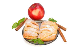 Buns with apple, cinnamon and mint sprinkled with powdered suga. R on a plate, and red apple with heart Royalty Free Stock Photography