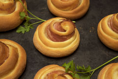 Buns with bacon. Buns curlicues from yeast dough with bacon Stock Images