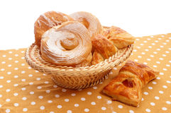 Buns in a basket. Many rolls in a basket on the tablecloth Royalty Free Stock Images