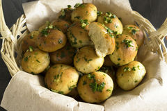 Buns. Basket with bread rolls with garlic and parsley Royalty Free Stock Image