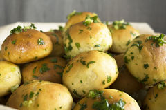 Buns. Basket with bread rolls with garlic and parsley Royalty Free Stock Photo