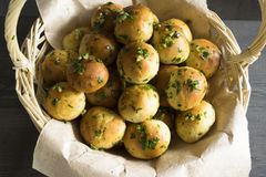 Buns. Basket with bread rolls with garlic and parsley Stock Image