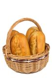 Buns in the bread basket on white background Stock Images