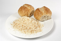 Buns and breadcrumb. Buns and creadcrumb on a white plate Stock Photos