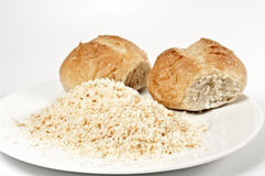 Buns and breadcrumb. Buns and creadcrumb on a white plate Stock Image