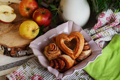 Buns and cakes heart rose in a still life, village Stock Images