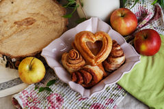 Buns and cakes heart rose in a still life, village Royalty Free Stock Photography