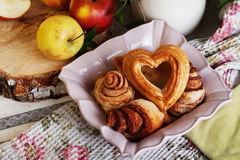 Buns and cakes heart rose in a still life, village Royalty Free Stock Image