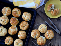 Buns with cheese and herbs in a pan. Or on a wooden background stock photos