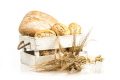 Buns and ciabatta, bread on wooden box. Barley and fresh mixed breads isolated on white background. Stock Photos