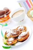 Buns with cinnamon and coffee on white Royalty Free Stock Images