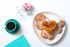 Buns with cinnamon and powdered sugar and a cup of coffee and a Stock Images