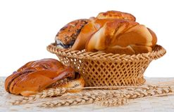 Buns with cinnamon and wheat ears. Isolated. White background Royalty Free Stock Images