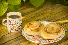 Buns and coffee Royalty Free Stock Images