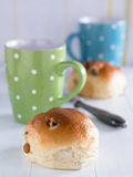 Buns with coffee cups Stock Photos