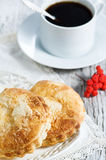 Buns and cup of coffee Stock Photos