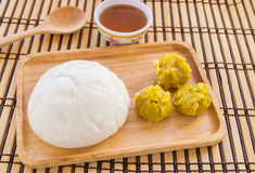 Buns and dumpling in wooden plate Stock Photography
