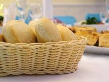 Buns in a wicker basket. Stock Photos