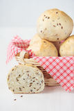 Buns with flax seeds in basket Stock Image