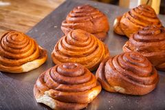 Buns in the form of snails stock images
