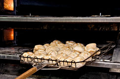 Buns freshly made in oven. Industrial oven and little buns freshly made Stock Photography