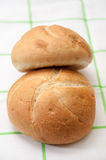 Buns on a green kitchen tablecloth Stock Photo