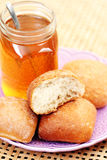 Buns and honey Stock Photo