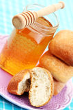 Buns and honey Stock Photos