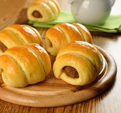 Buns with meat. On a brown table royalty free stock images