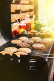 Buns and meat chops cooked outdoors on grill royalty free stock photo