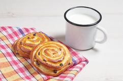 Buns and mug with milk Stock Image