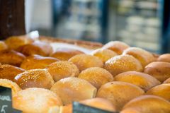 Bakery products on display. Buns and pastries in a basket on the bakery shop window stock images