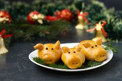 Buns `Pigs` for the New Year. Homemade baking stock photos
