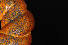 Buns with poppy seeds. Isolated on black background Stock Photos