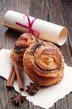 Buns with poppy seeds and roll paper Royalty Free Stock Photo