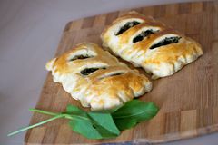 Buns of puff pastry with sorrel close-up. Tasty homemade cakes with greens. Buns of puff pastry with sorrel close-up. Homemade cakes with greens stock photography