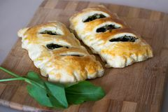 Buns of puff pastry with sorrel close-up. Tasty homemade cakes with greens. Buns of puff pastry with sorrel close-up. Homemade cakes with greens royalty free stock photo