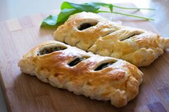 Buns of puff pastry with sorrel close-up. Tasty homemade cakes with greens. Buns of puff pastry with sorrel close-up. Homemade cakes with greens royalty free stock photography