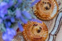 Buns with raisins. Dessert. Bouquet of lavender flowers. royalty free stock image
