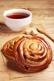 Buns with raisins and tea Stock Images