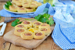 Buns with sausage, cheese and eggs Stock Photo