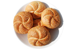 Buns with seasam seeds. Isolated on white bred rolls with seasam on white plate Royalty Free Stock Photography