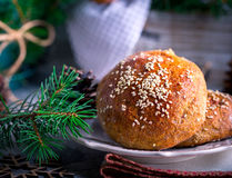 Buns with sesame on plate Stock Photos