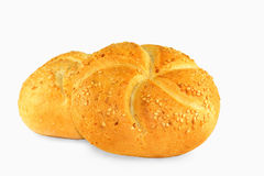 Buns with sesame seeds on white. Two golden buns with sesame seeds isolated on white background stock images