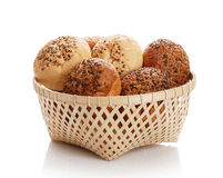 Buns with sesame in a woven basket Stock Images