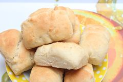Buns. Some fresh homemade buns with wheat royalty free stock photography