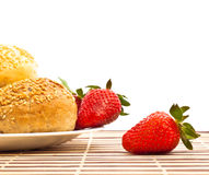 Buns and strawberry Stock Photo